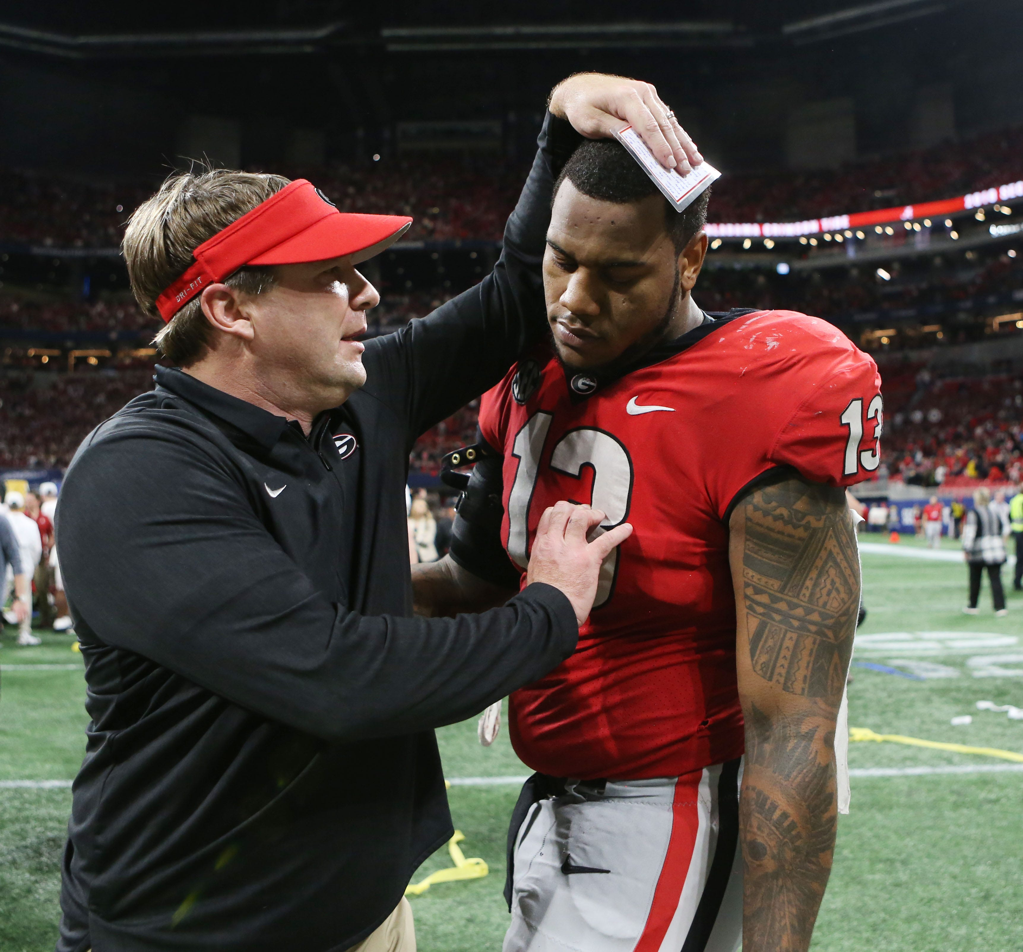 Georgia coach Kirby Smart consoles defensive end Jonathan Ledbetter after their loss to Alabama in the 2018 SEC championship game.