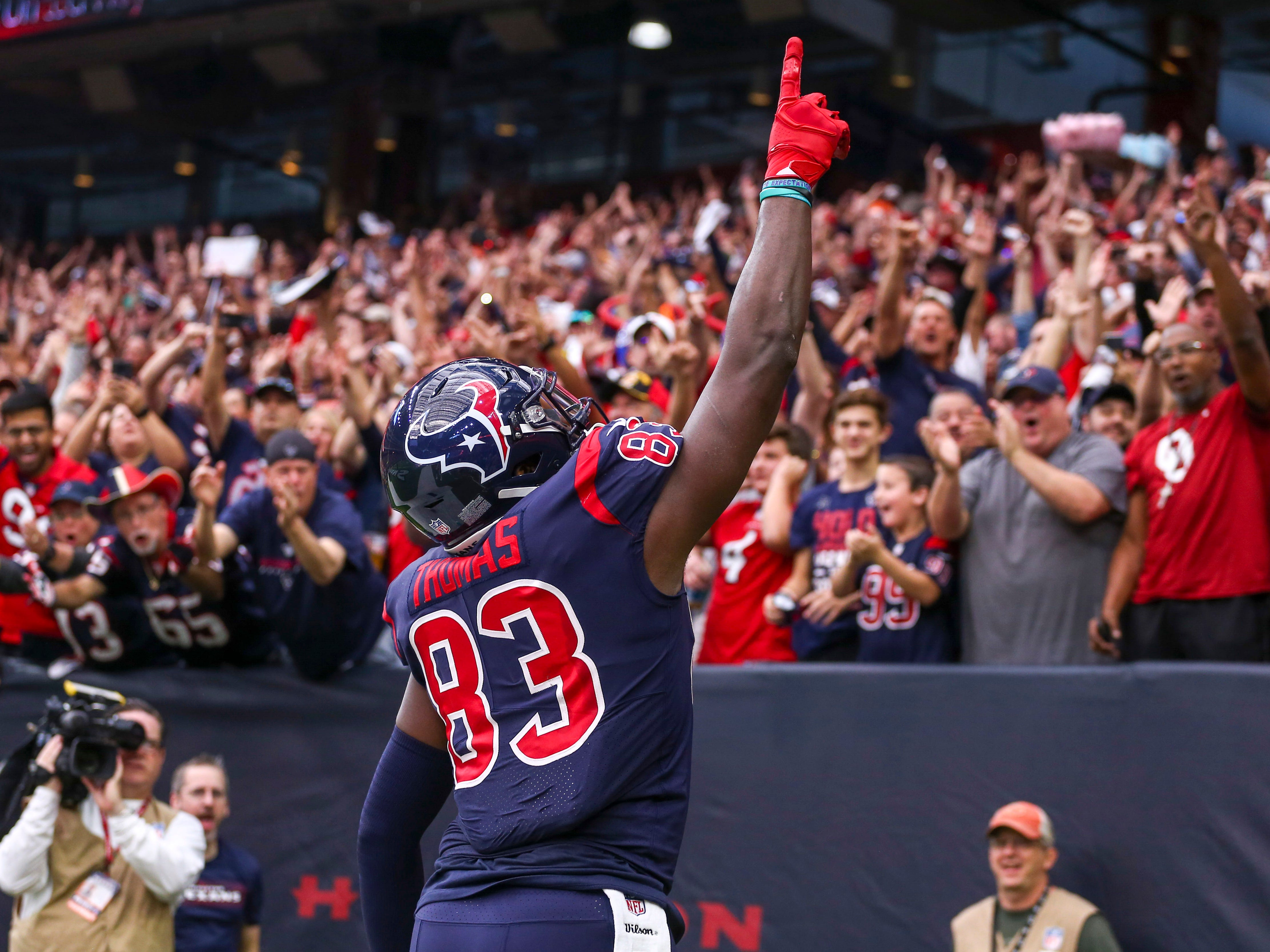 Dec 2, 2018; Houston, TX, USA; Houston Texans tight end Jordan Thomas (83) celebrates after catching a touchdown  pass during the first quarter against the Cleveland Browns at NRG Stadium. Mandatory Credit: John Glaser-USA TODAY Sports ORG XMIT: USATSI-381566 ORIG FILE ID:  20181202_lbm_ga2_054.JPG