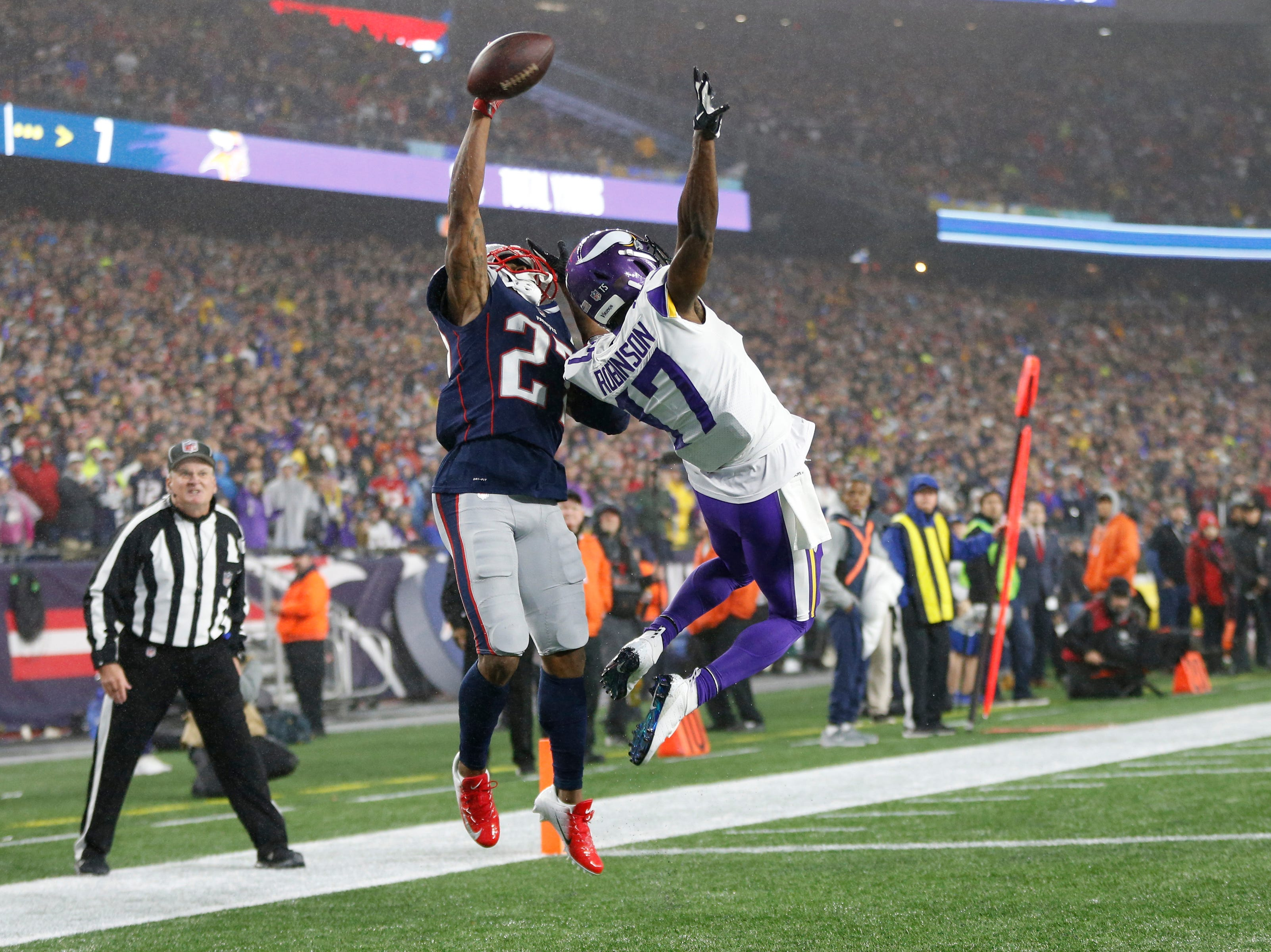Patriots cornerback J.C. Jackson attempts to intercept a pass intended for Vikings wide receiver Aldrick Robinson during the third quarter.