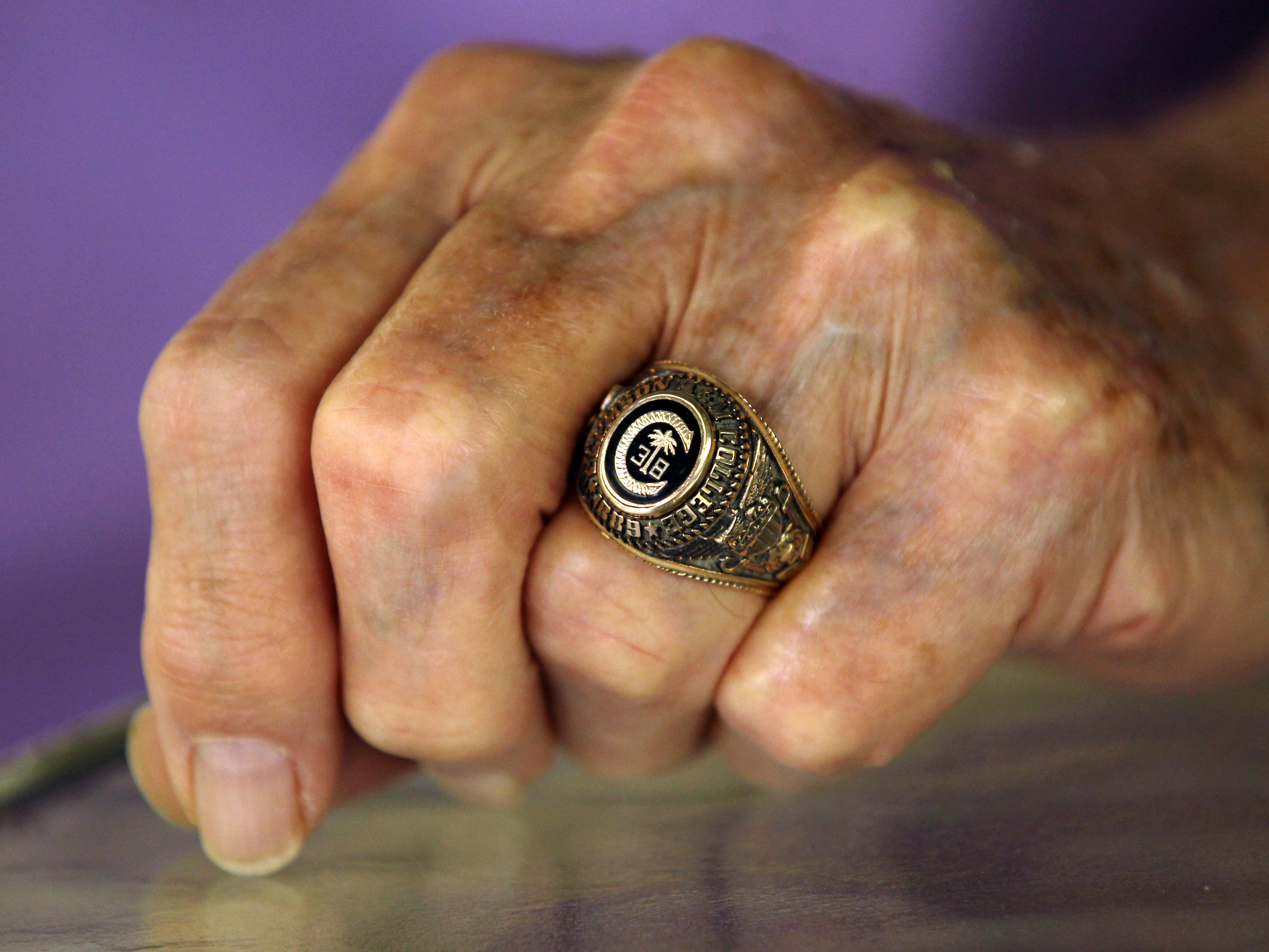 Ben Skardon wears a replica of his 1938 Clemson graduation ring that he used to barter for food during the Bataan Death March.