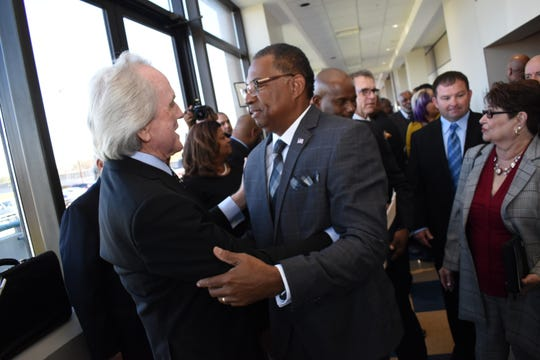 Newly inaugurated mayor of Alexandria Jeff Hall talks with attorney Mike Small (left) who gave opening remarks at Hall's inauguration ceremony held Monday, Dec. 3, 2018 at Hall's inauguration. With Hall is his wife Patricia Breaux Hall (right).