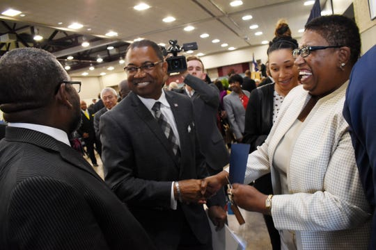 Newly inaugurated mayor of Alexandria Jeff Hall (center) is greets constituents after Hall's inauguration ceremony Monday, Dec. 3, 2018 at Hall's inauguration.