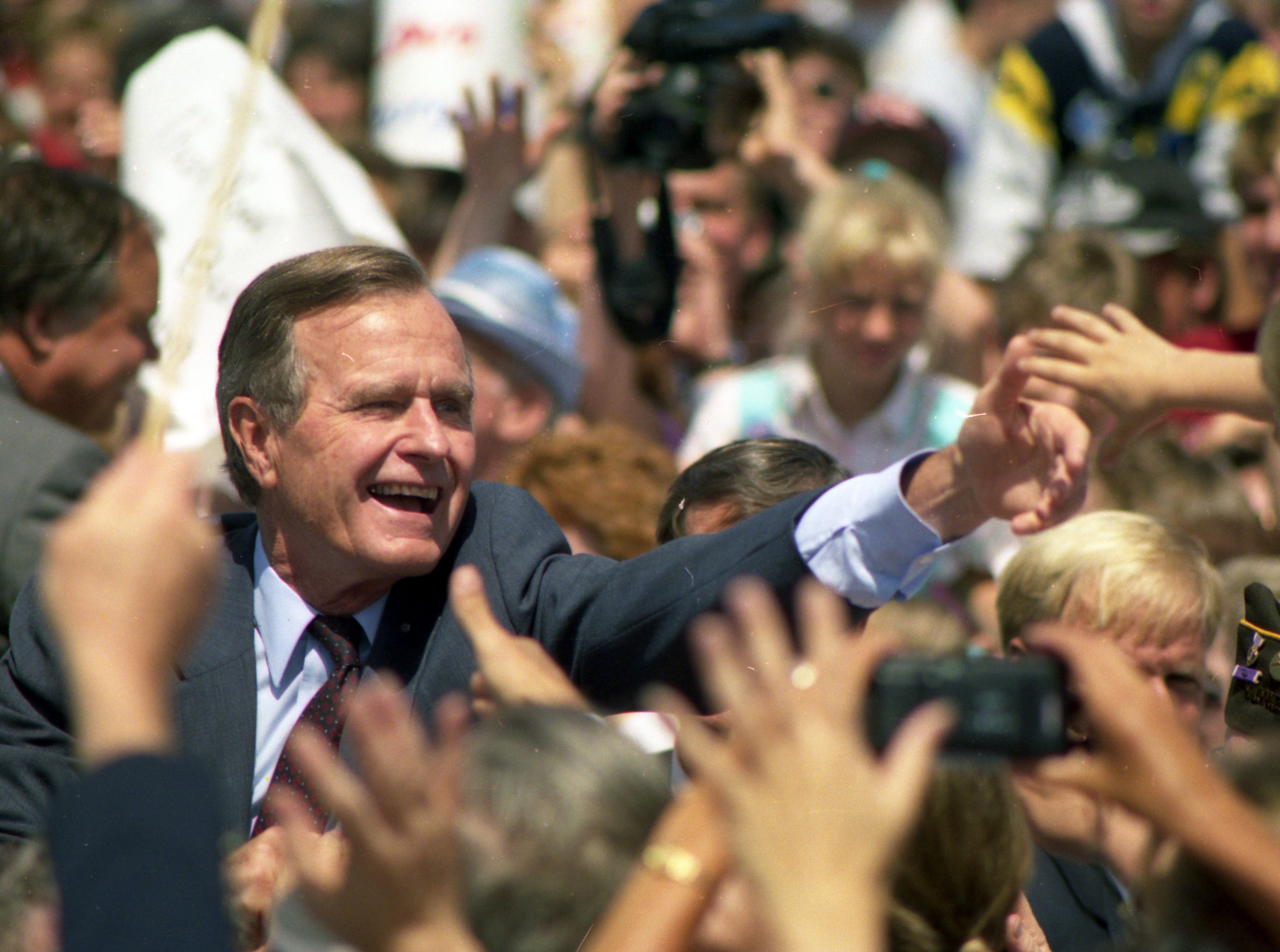 July 27, 1992. President George H. W. Bush spread a Republican campaign message in the Fox Cities and took time to greet some of the thousands of well-wishers at the Outagamie County Airport. Post-Crescent photo by Mark Courtney