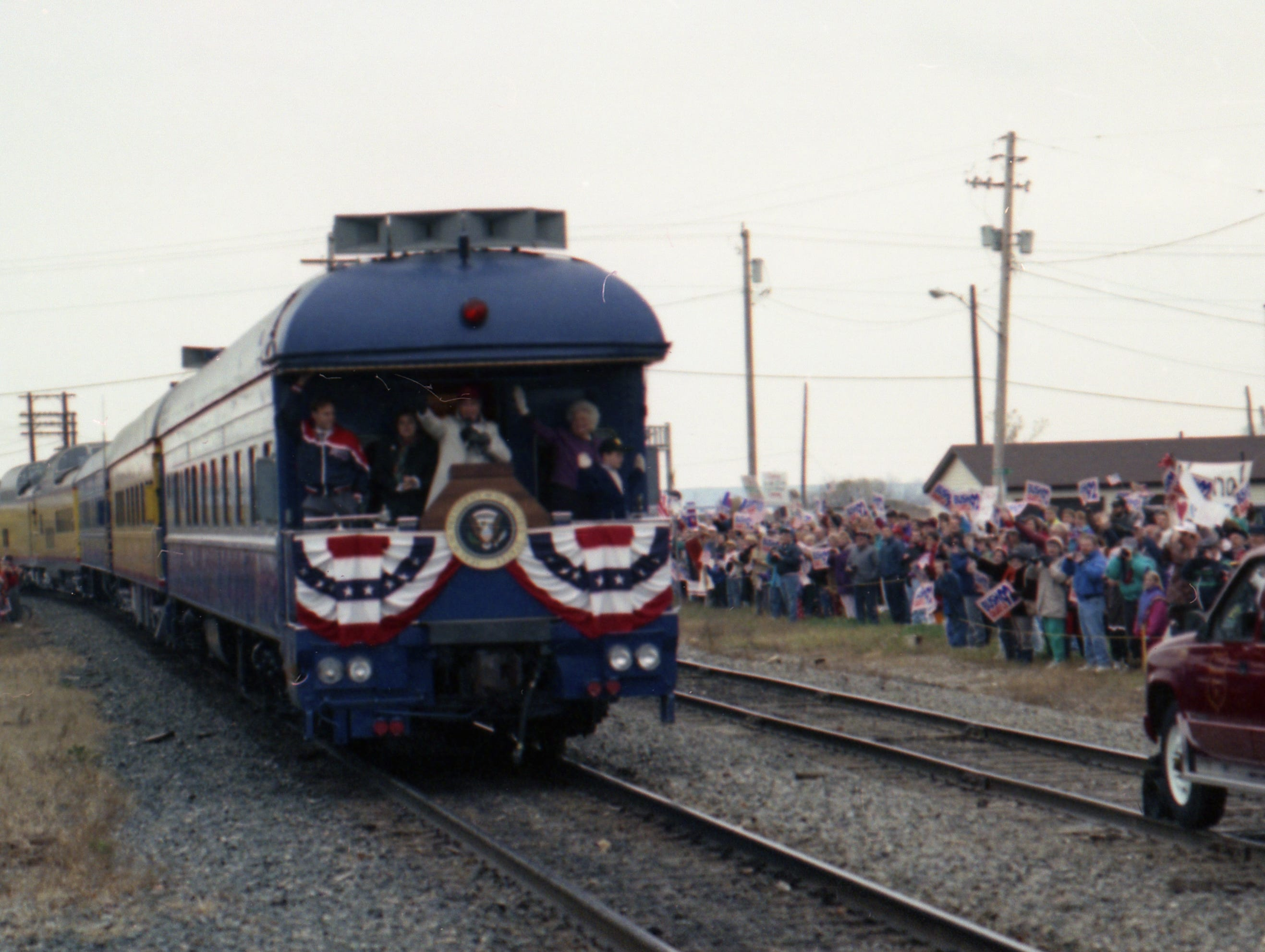 "Oct. 31, 1992. President George H. W. Bush aboard the ""Spirit of America""  whistle-stop campaign train passed through Neenah, Dale, Weyauwega, Waupaca, Amherst and Amherst Junction on the way to Stevens Point. Post-Crescent photo by Michael Leschisin"