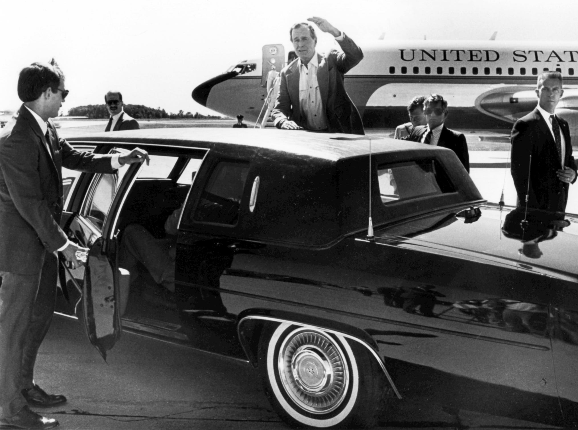 June 29, 1988. Secret Service agents protect Vice President George H. W. Bush at the Outagamie County Airport.  Bush was on his way to the Midwest LIvestock Producers auction barn in Marion. Post-Crescent photo by Bob Baeten.