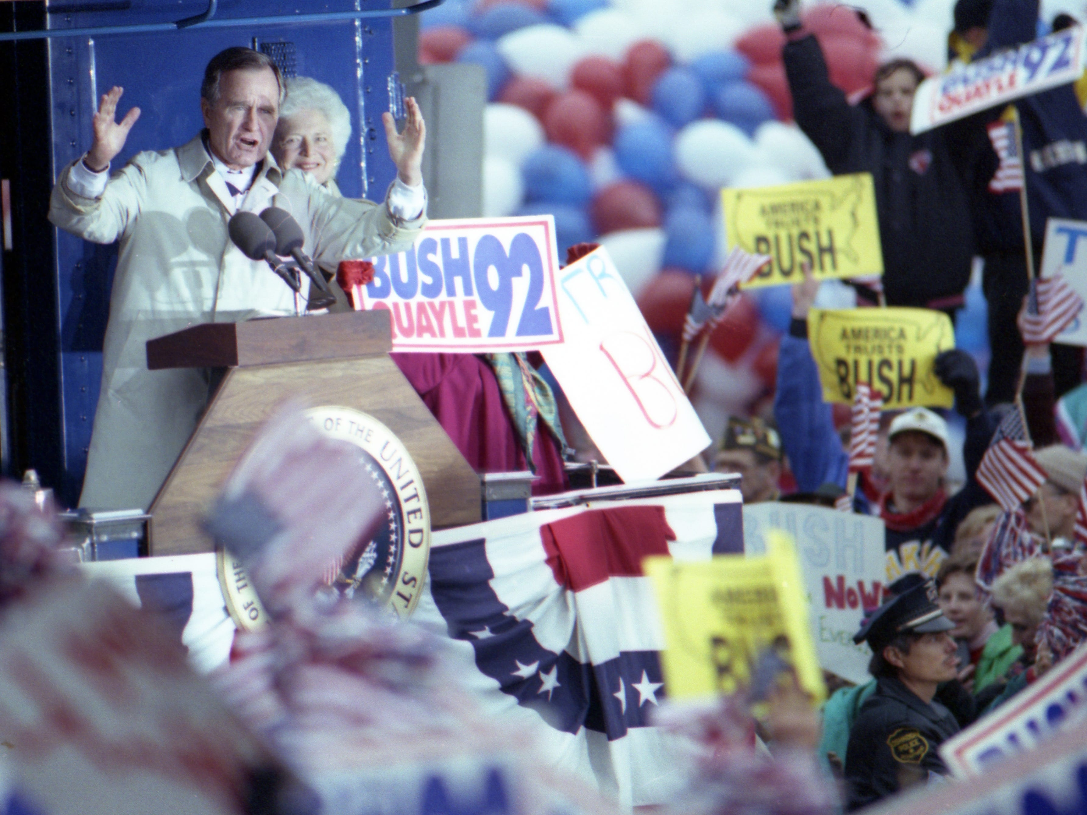 """Oct. 31, 1992. President George H. W. Bush aboard the """"Spirit of America""""  whistle-stop campaign train passed through Neenah, Dale, Weyauwega, Waupaca, Amherst and Amherst Junction on the way to Stevens Point. Post-Crescent photo by Michael Leschisin"""
