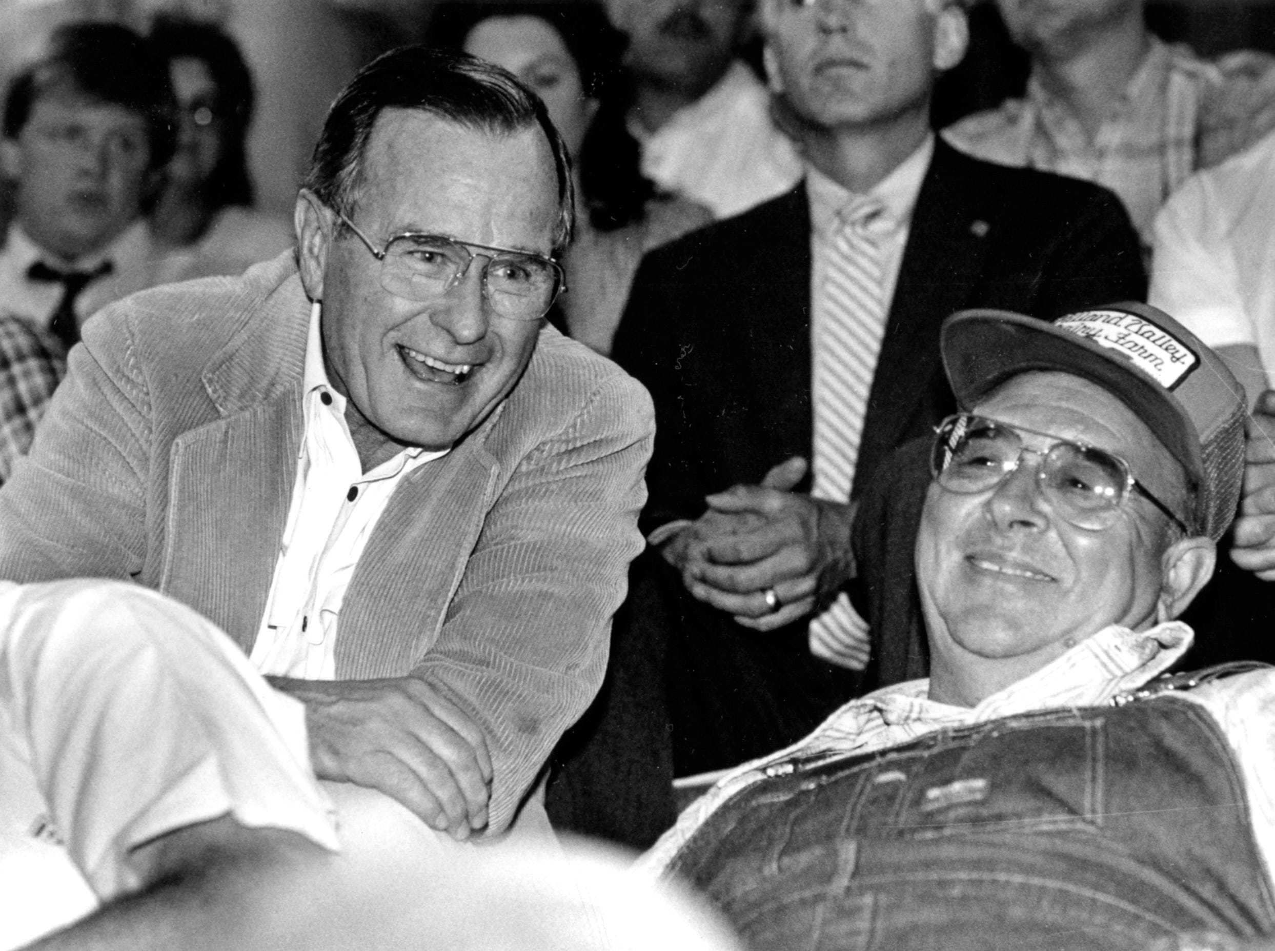 June 29, 1988. Vice President George H. W. Bush sits with Gordon Gruenstern in the stands of the Livestock Producers arena in Marion, Wisconsin. Post-Crescent photo by Scott Whitcomb.