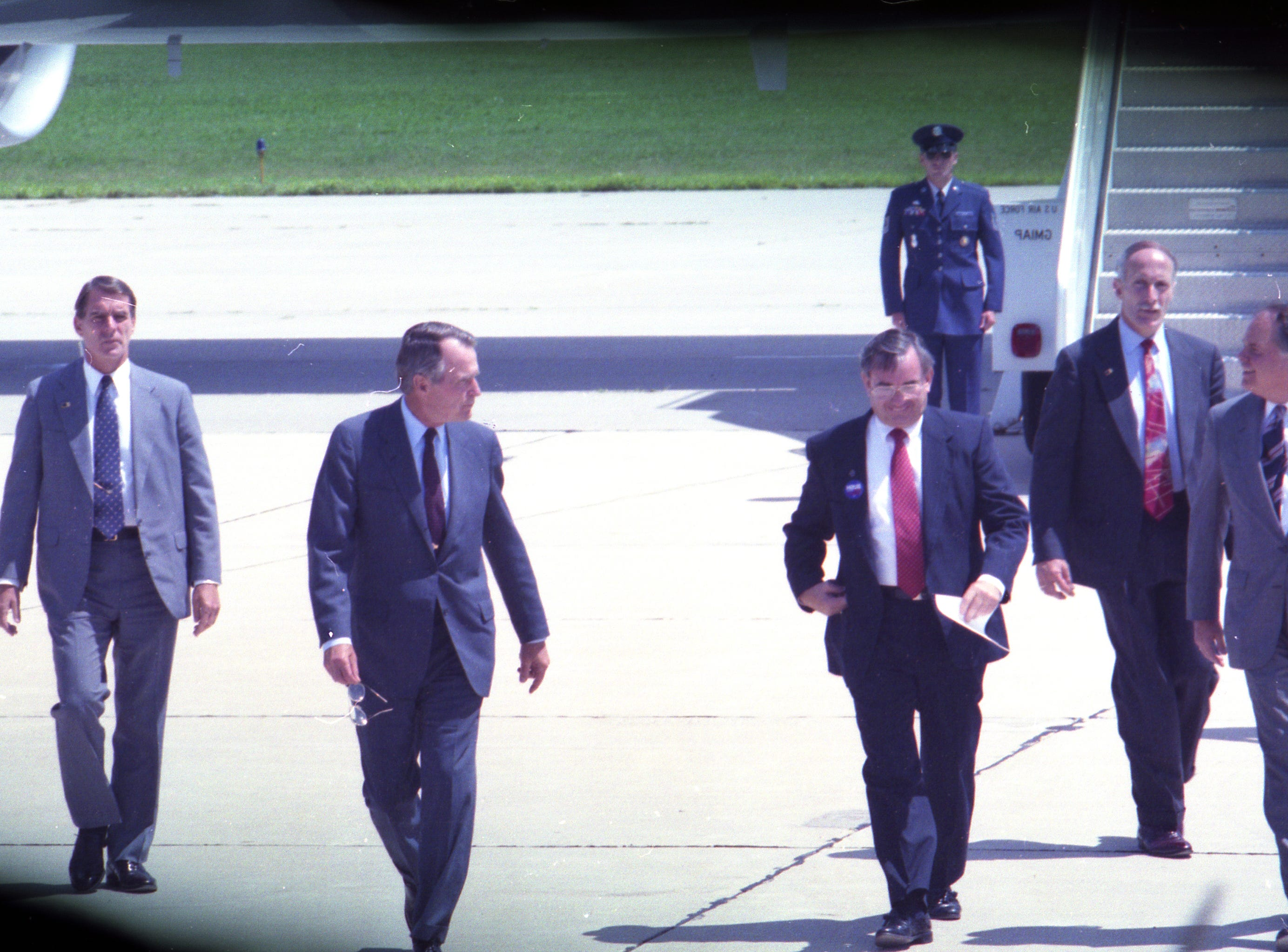July 27, 1992 President George H. W. Bush and Gov. Tommy Thompson at the Outagamie County Airport. President George H. W. Bush spread a Republican campaign message in the Fox Cities and took time to greet some of the thousands of well-wishers at the Outagamie County Airport. Post-Crescent photo by Mark Courtney
