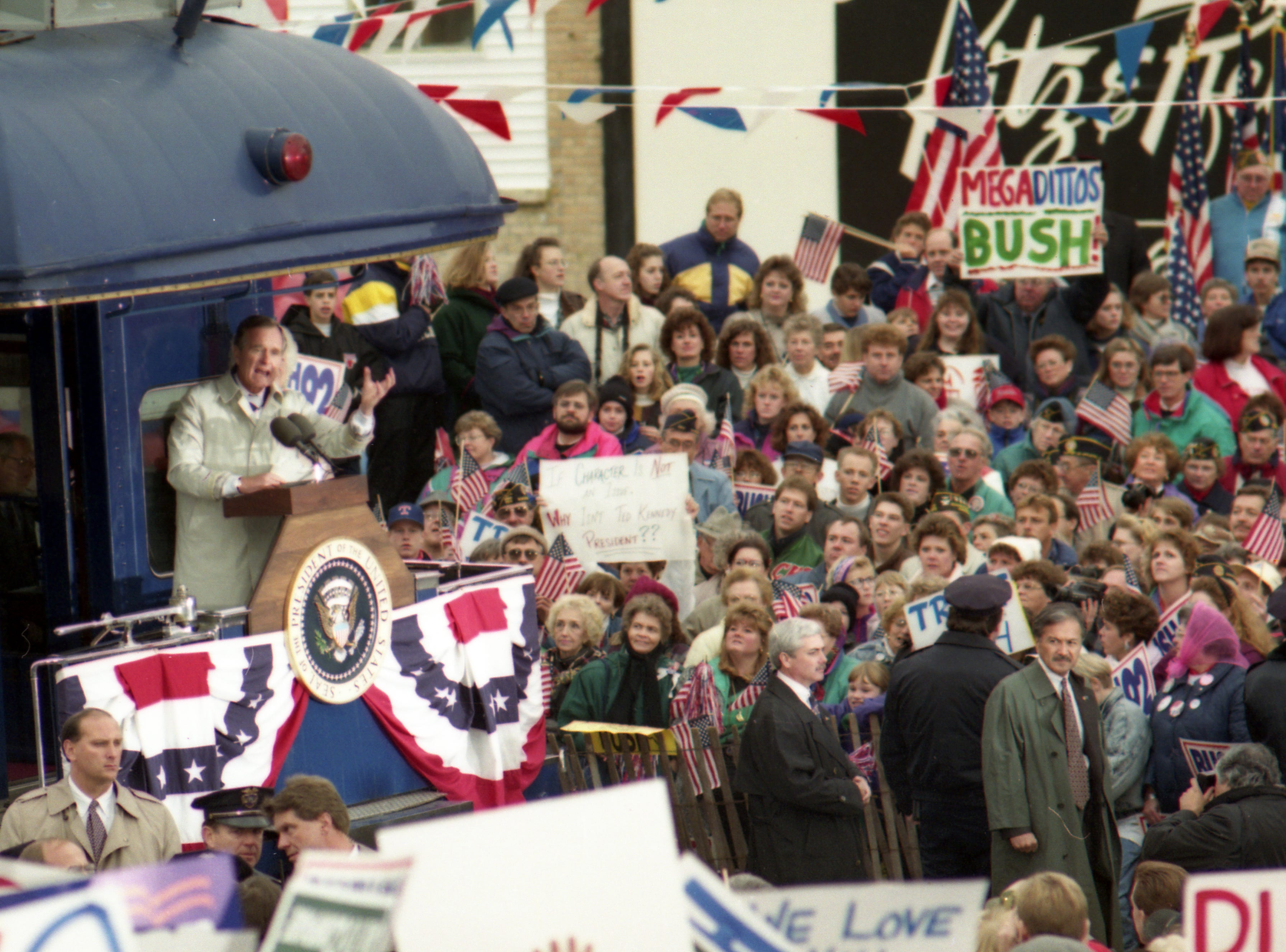 "Oct. 31, 1992. President George H. W. Bush spoke from the caboose of his ""Spirit of America"" train to an Oshkosh crowd estimated at around 5,000 supporters. The whistle-stop campaign passed through Neenah, Dale, Weyauwega, Waupaca, Amherst and Amherst Junction on the way to Stevens Point. Post-Crescent photo by Michael Leschisin"