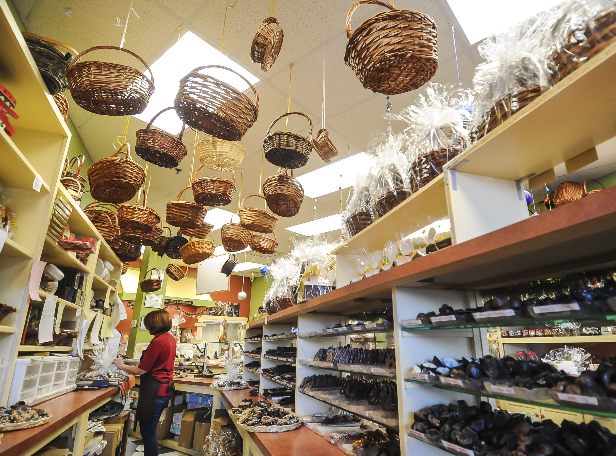 Baskets hang at Suzi's Sweet Shoppe, a Middletown family-owned business. The family-owned business offers hand-dipped chocolates, gift baskets, party favors, and homemade fudge.