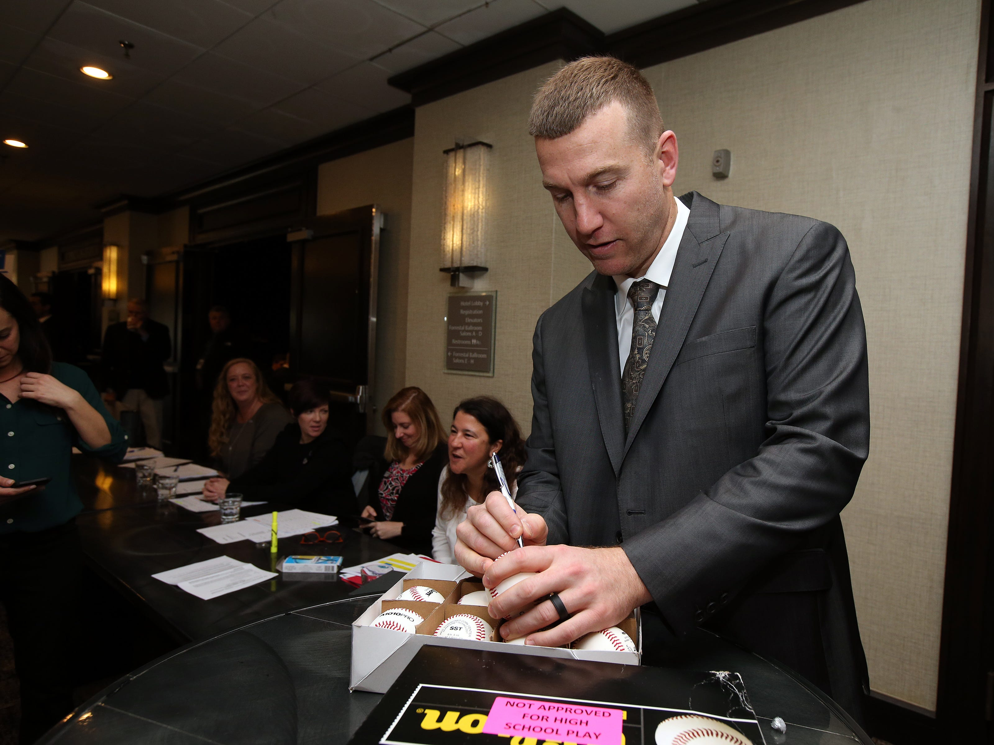 Todd Frazier of the New York Mets, and a Toms River native, signs baseballs before being inducted into the NJSIAA Hall of Fame at the Westin Princeton at Forrestal Village in Princeton, NJ Monday, December 3, 2018.