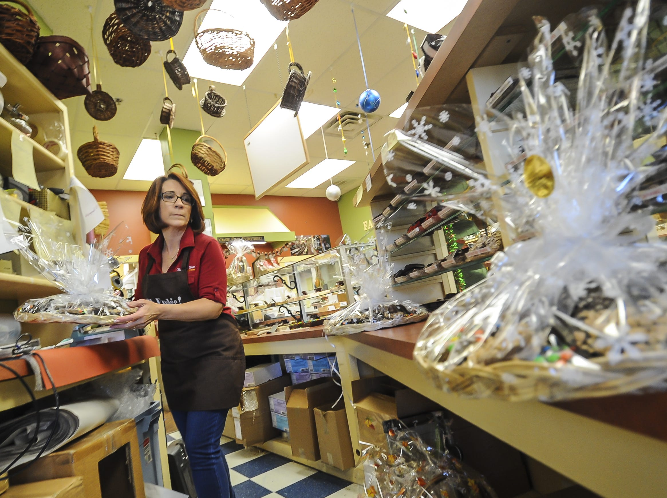 Susan Hordych owner of Suzi's Sweet Shoppe, a Middletown family-owned business, prepares platters. The family-owned business offers hand-dipped chocolates, gift baskets, party favors, and homemade fudge.