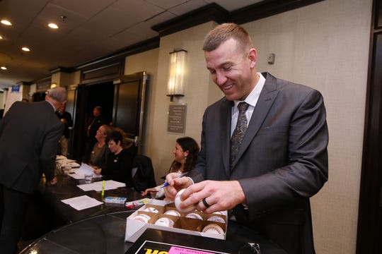 Todd Frazier of the New York Mets, and a Toms River native, signs baseballs before being inducted into the NJSIAA Hall of Fame at the Westin Princeton at Forrestal Village in Princeton, on Dec. 3, 2018.