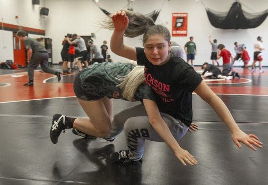 Kayla Gregory gets taken down by Avery Meyers during Jackson Memorial wrestling practice.
