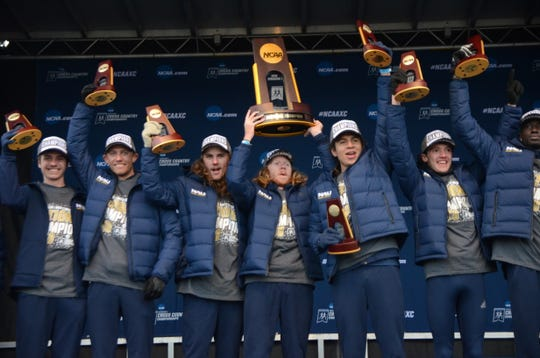 Blaise Ferro (2nd from right) celebrates with the NCAA champion Northern Arizona men's cross country team.