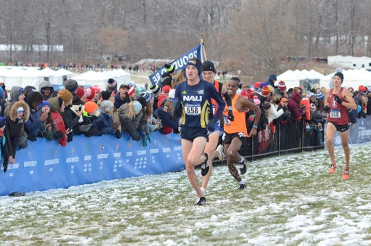 Blaise Ferro (No. 558, in blue) races for Northern Arizona at the NCAA cross country championship.