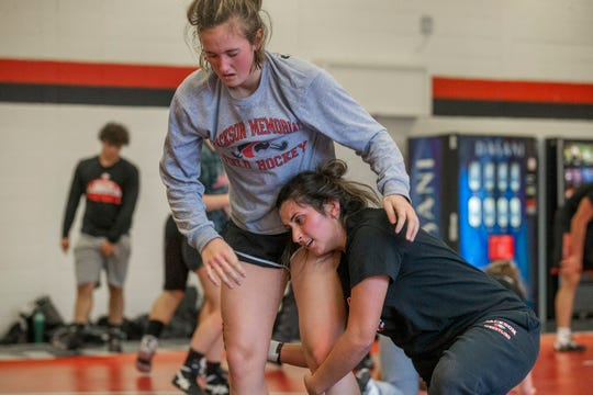 Brandi Rado and Abby Stanberry work on takedowns. NJSIAA is offering wrestling for girls this year and they will participate in an all girls tournament at the end of the season. Jackson Memorial Wrestling is fielding a full girls team this year. Boy and girls practice together although mostly match up with partners of their own sex for most drills.