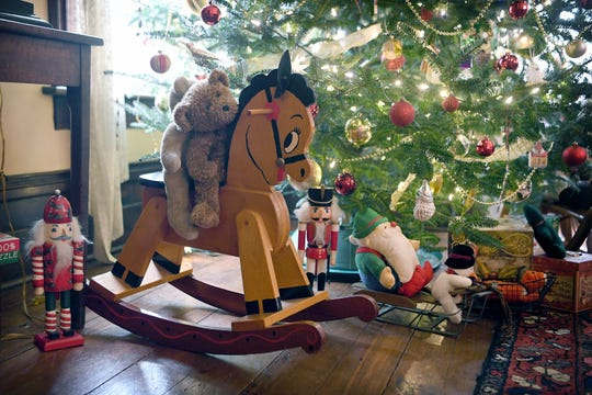 A rocking horse made by Karen Nagle's father as a Christmas present when her daughter was young is on display next to the tree at the Mountain Magnolia Inn in Hot Springs.