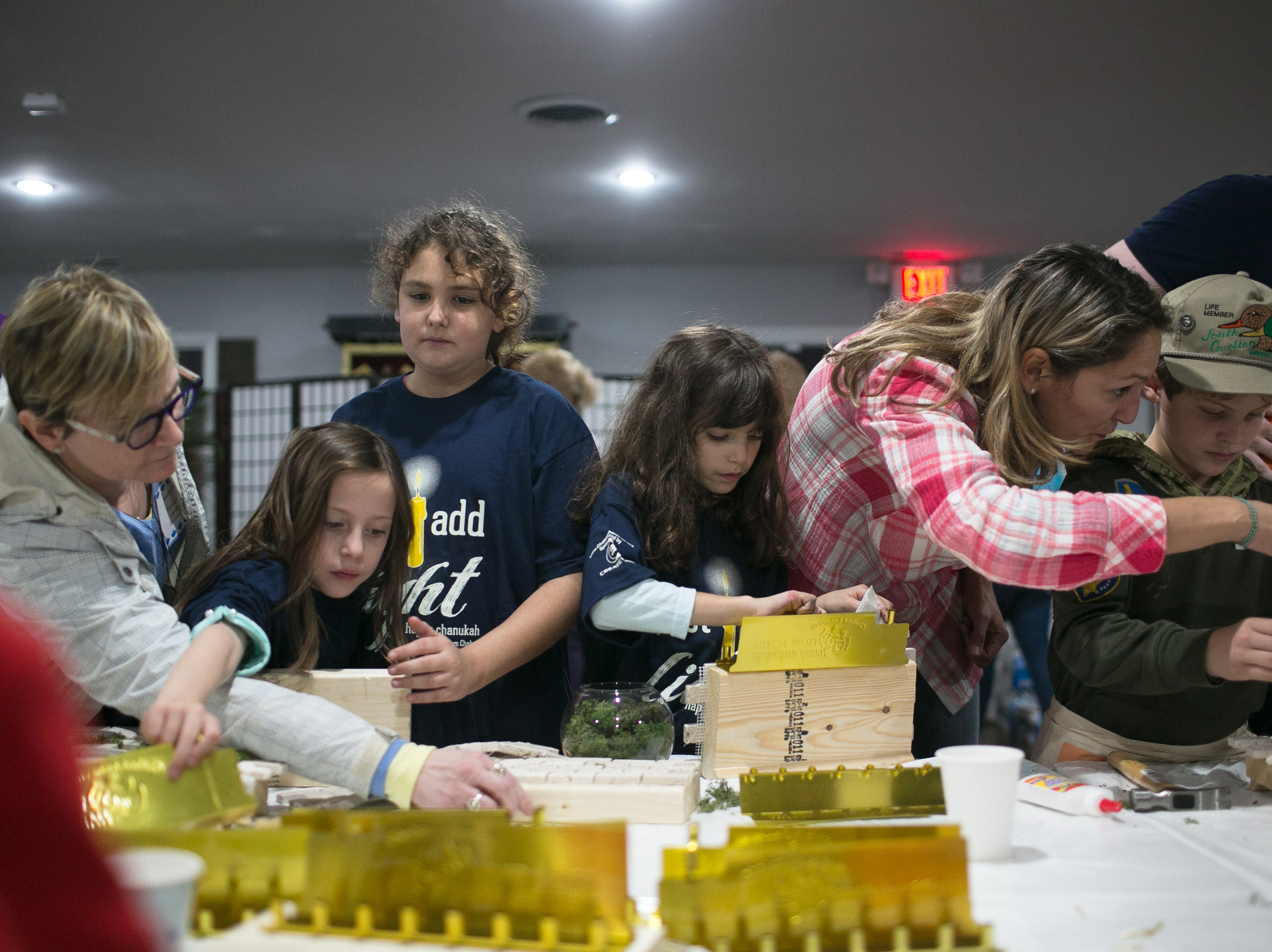 The Home Depot hosted a Western Wall Menorah building for kids during Chanukah Live!, Asheville's community Hanukkah celebration on Dec. 2, 2018.