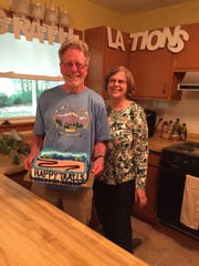 Mary Fond Daughtridge surprised her husband, Bob DeBrecht, with a cake when he completed the South Beyond 6,000 Hiking Challenge.