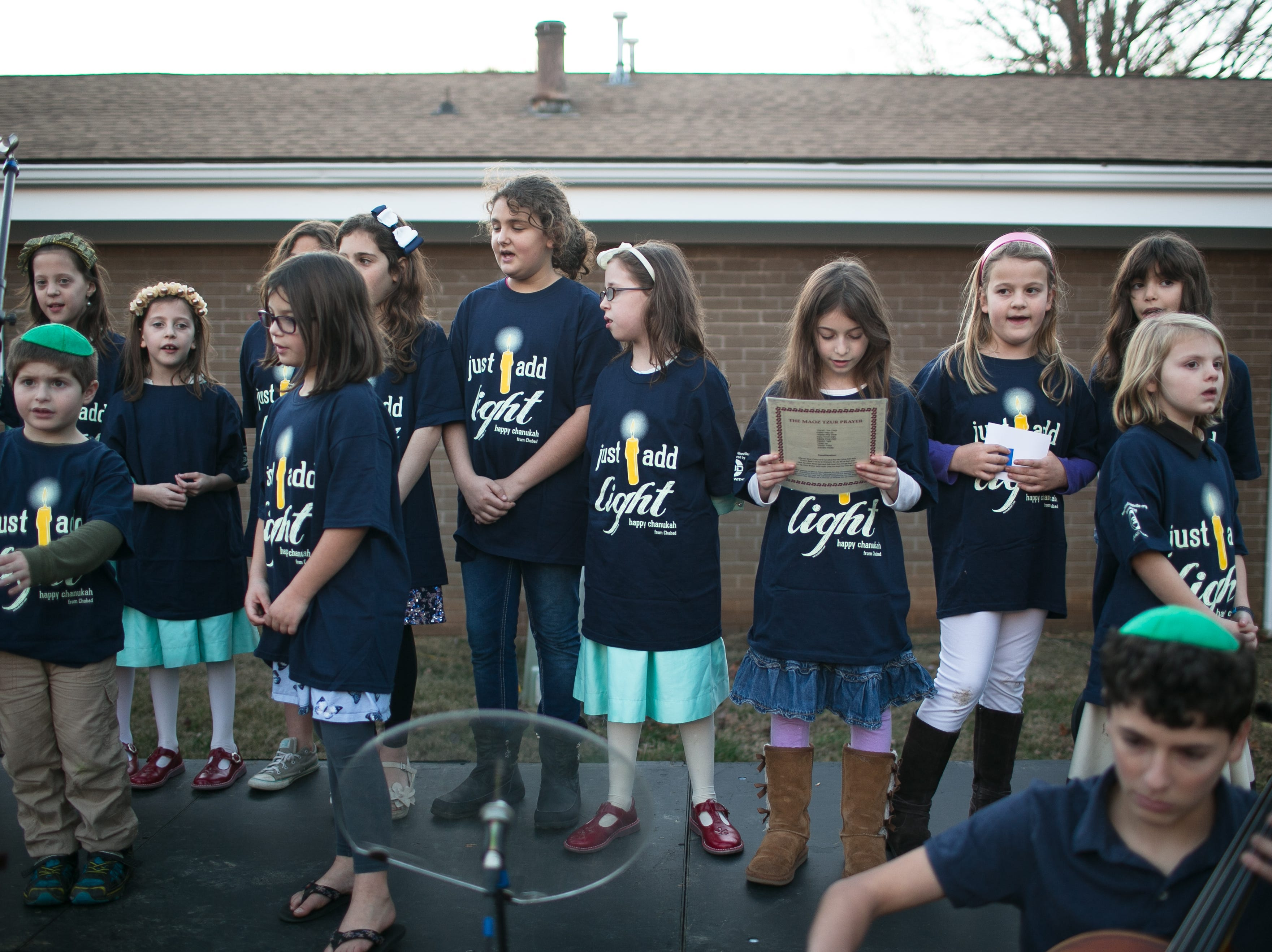 The Chabad Hebrew School of the Arts Sunday School performs during Chanukah Live!, Asheville's community Hanukkah celebration. The event was held at the Chabad House on Dec. 2, 2018, in conjunction with the grand opening of their new facility on McDowell Street.