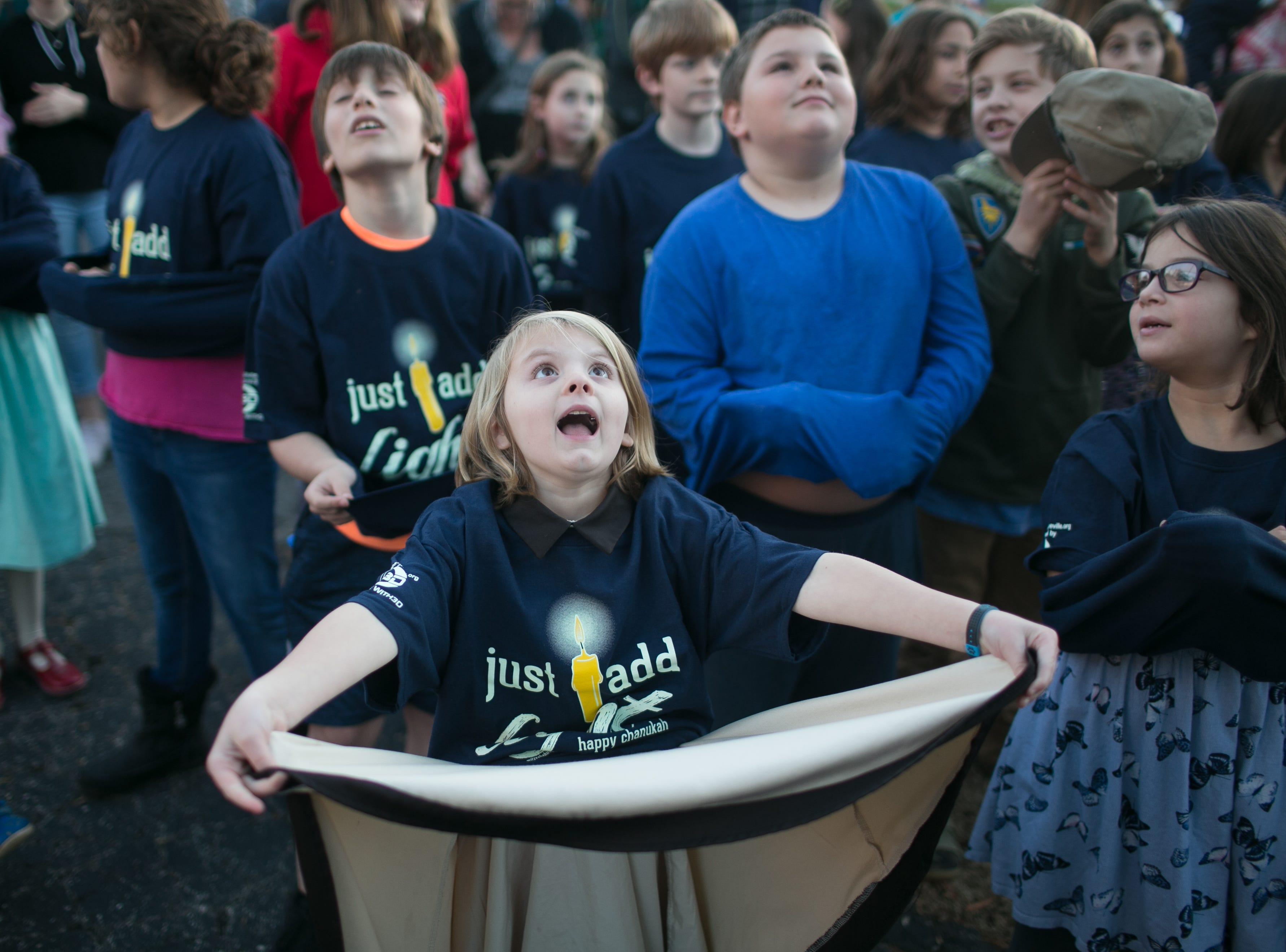 Kids wait for chocolate to fall during the Great Gelt Drop at Chanukah Live!, Asheville's community Hanukkah celebration. The event was at the Chabad House on Dec. 2, 2018 in conjunction with the grand opening of their new facility on McDowell Street.