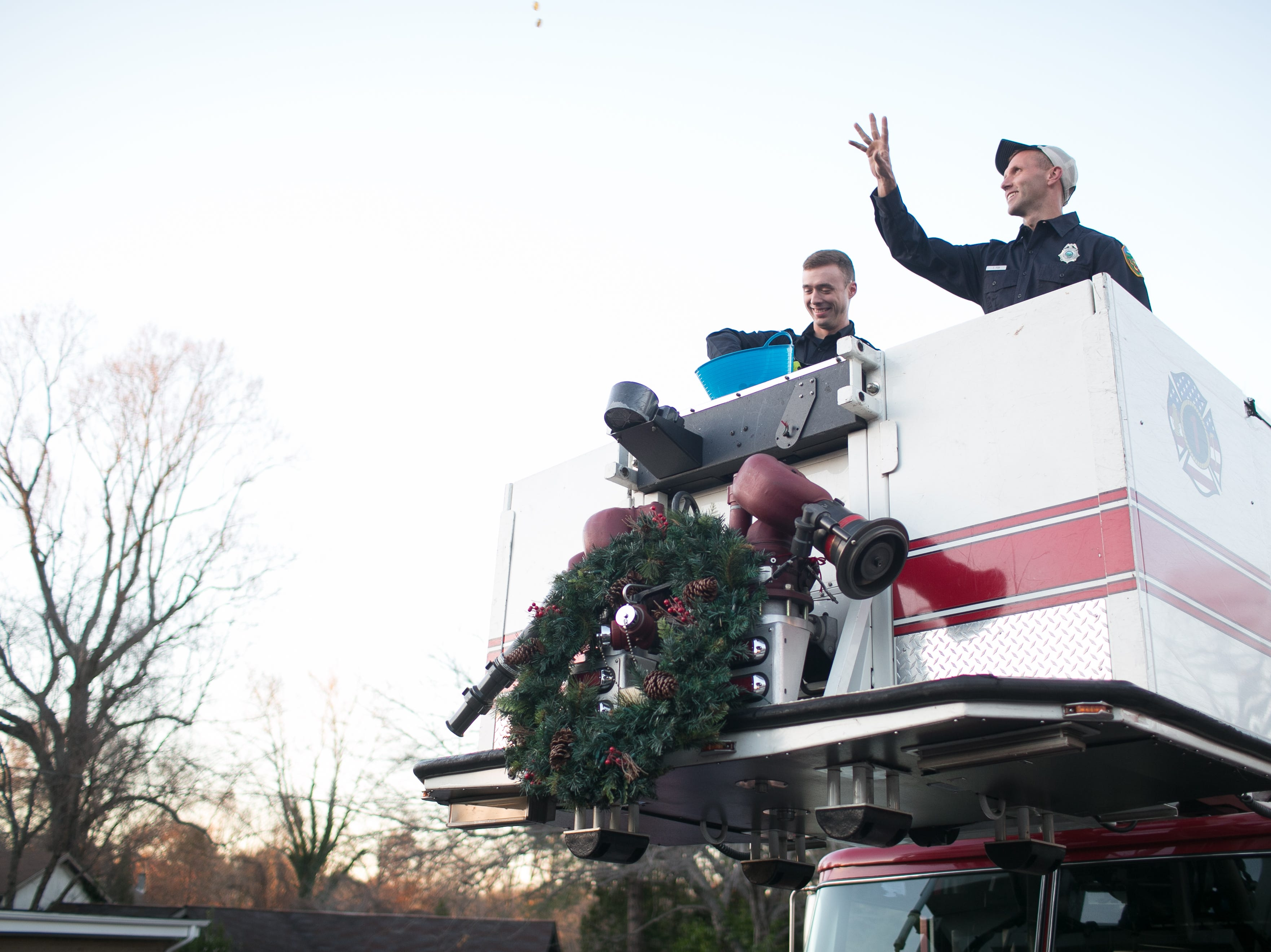 Asheville Fire Department helps with The Great Gelt Drop during Chanukah Live!, Asheville's community Hanukkah celebration. The event was at the Chabad House on Dec. 2, 2018, in conjunction with the grand opening of their new facility on McDowell Street.