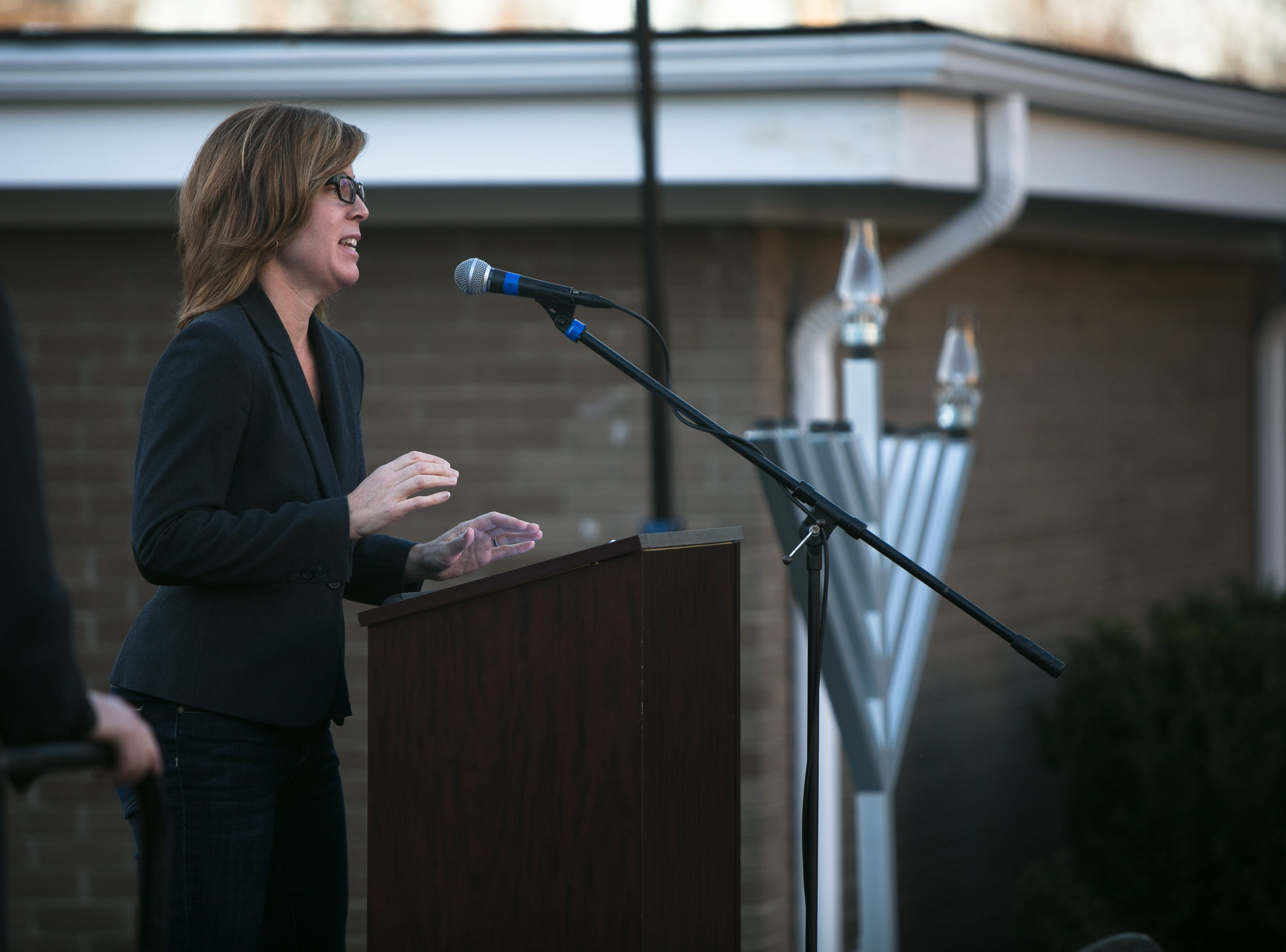 Asheville Mayor Esther Manheimer speaks during Chanukah Live!, Asheville's community Hanukkah celebration.