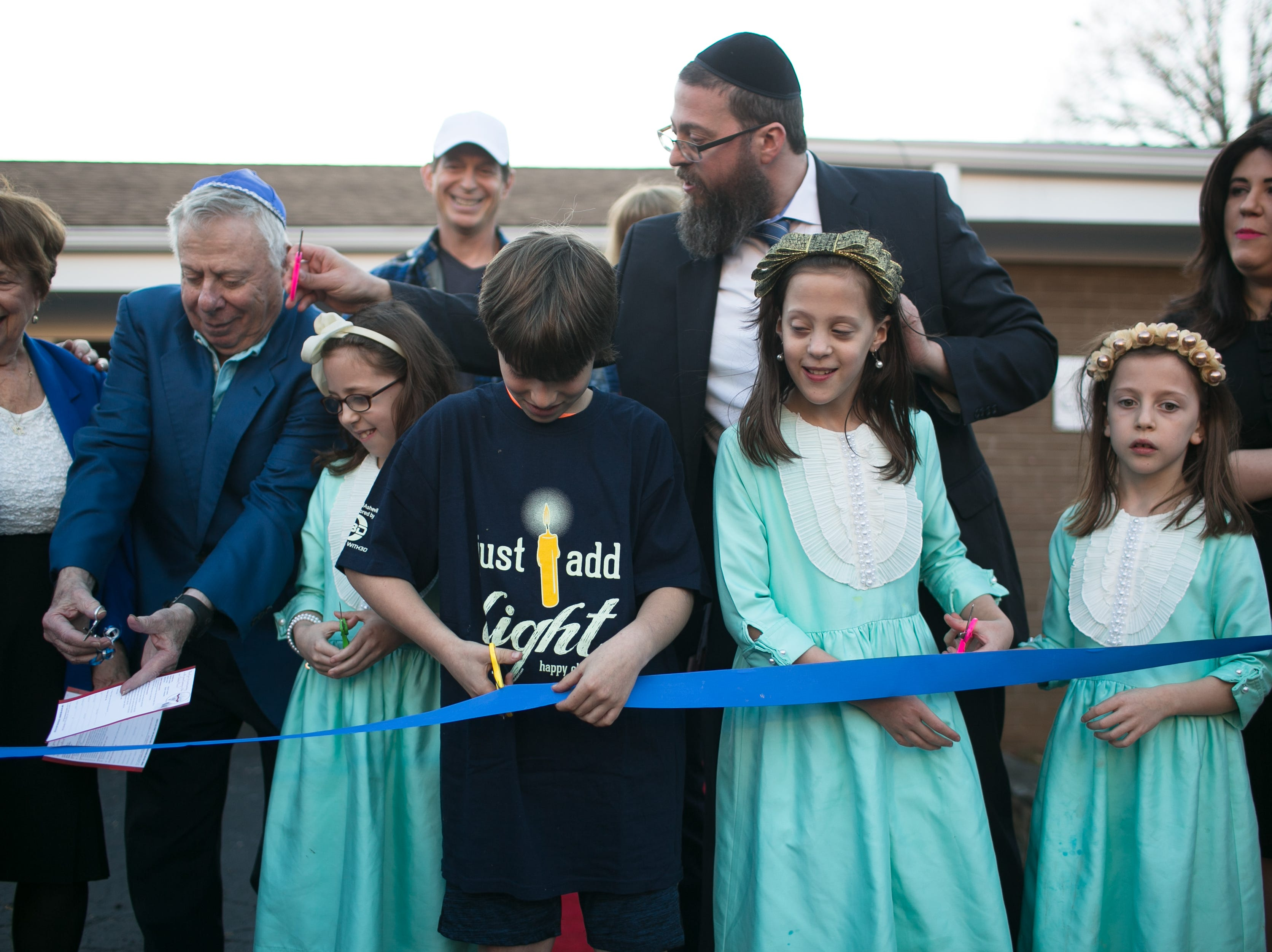 A ribbon cutting was held for the grand opening of the new Chabad House location on McDowell Street, in conjunction with Chanukah Live!, Asheville's community Hanukkah celebration. The event was held at the Chabad House on Dec. 2, 2018.