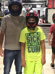 """Scott Kavulich prepares to ride a go cart with his """"little brother."""" Kavulich is a Big Brother for Big Brothers Big Sisters of the Twin Tiers, which does not identify the youths involved in the program."""