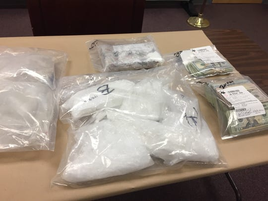 Kilos of fentanyl (top), meth (bottom) and heroin (left) were seized during a drug raid in the Village of Deposit.