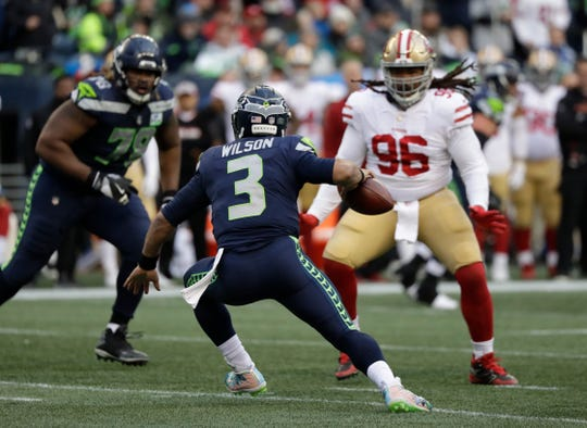 Seattle Seahawks quarterback Russell Wilson (3) scrambles against the San Francisco 49ers.