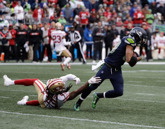 San Francisco 49ers cornerback Richard Sherman (left) can't hold on to Seattle Seahawks wide receiver Doug Baldwin following Baldwin's second-half catch.