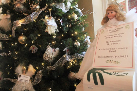 """The Swannanoa Valley Christian Ministry tree recognizes the Black Mountain organization's volunteers as """"The Angels Among Us."""""""
