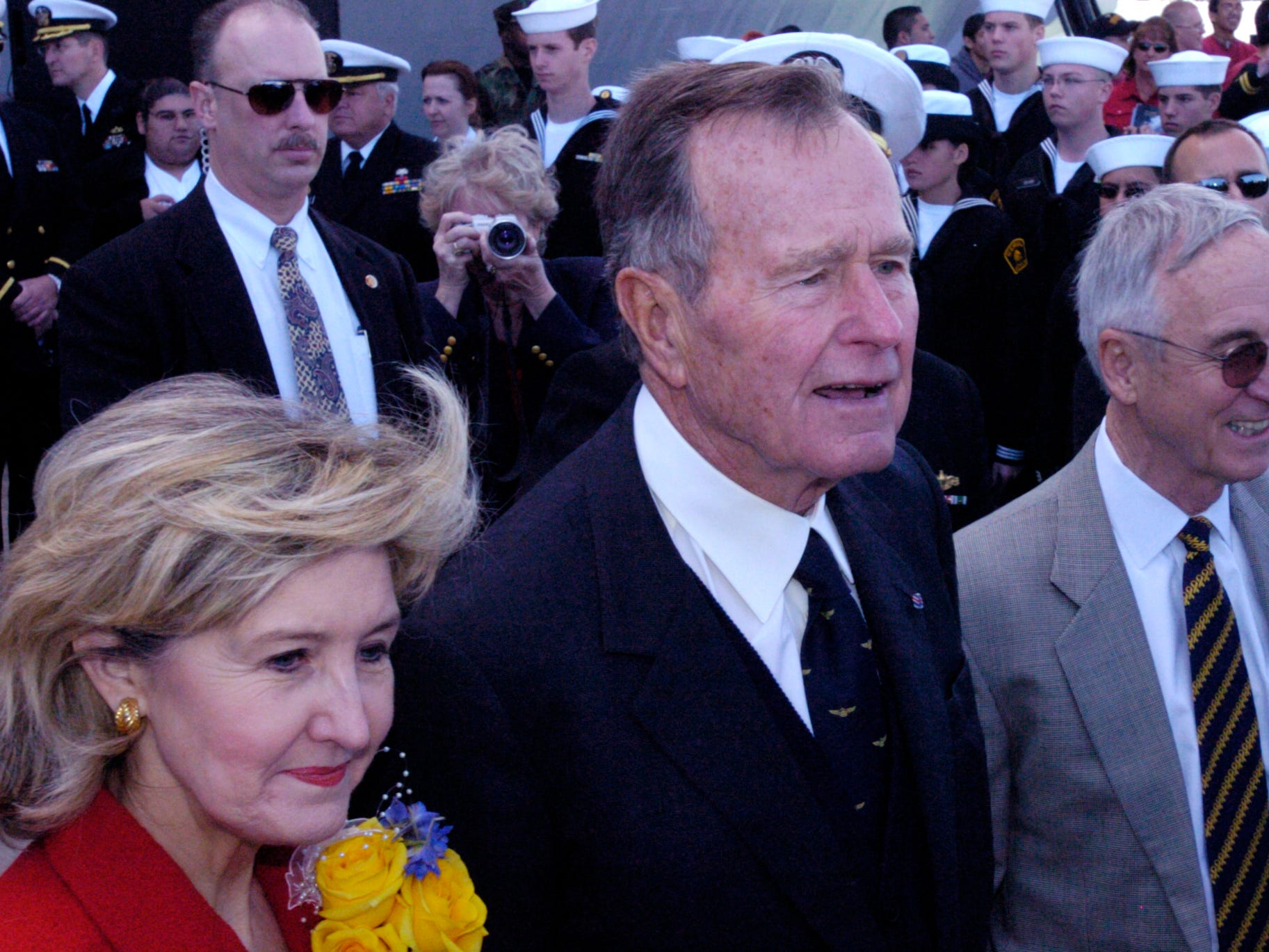 Former President George H.W. Bush (center) and U.S. Sen. Kay Bailey Hutchison (right) participate in the commissioning ceremony of the USS San Antonio at Naval Station Ingleside in January 2006. Former President Bush gave the principal address at the ceremony.