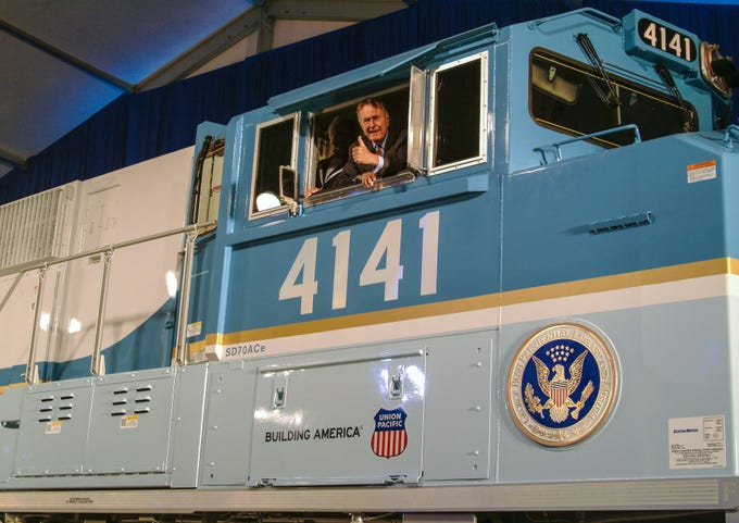 George H.W. Bush in the cab of Union Pacific Locomotive No. 4141 at its 2005 unveiling.