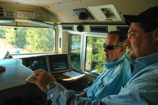 President George H.W. Bush in the cab of UP locomotive No. 4141.