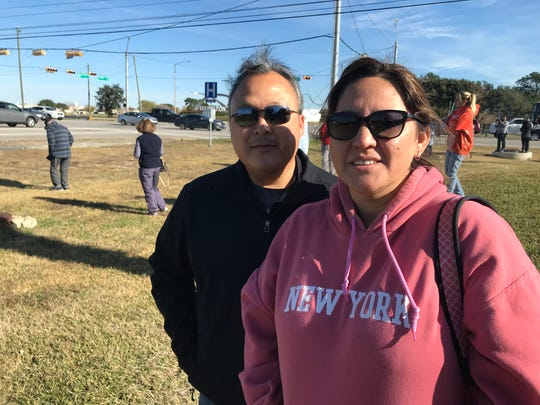 Matthew and Jessica Carrion wait outside Ellington Field in Houston for the body of former President George H.W. Bush to be flown to Washington. D.C., on Dec. 3, 2018.