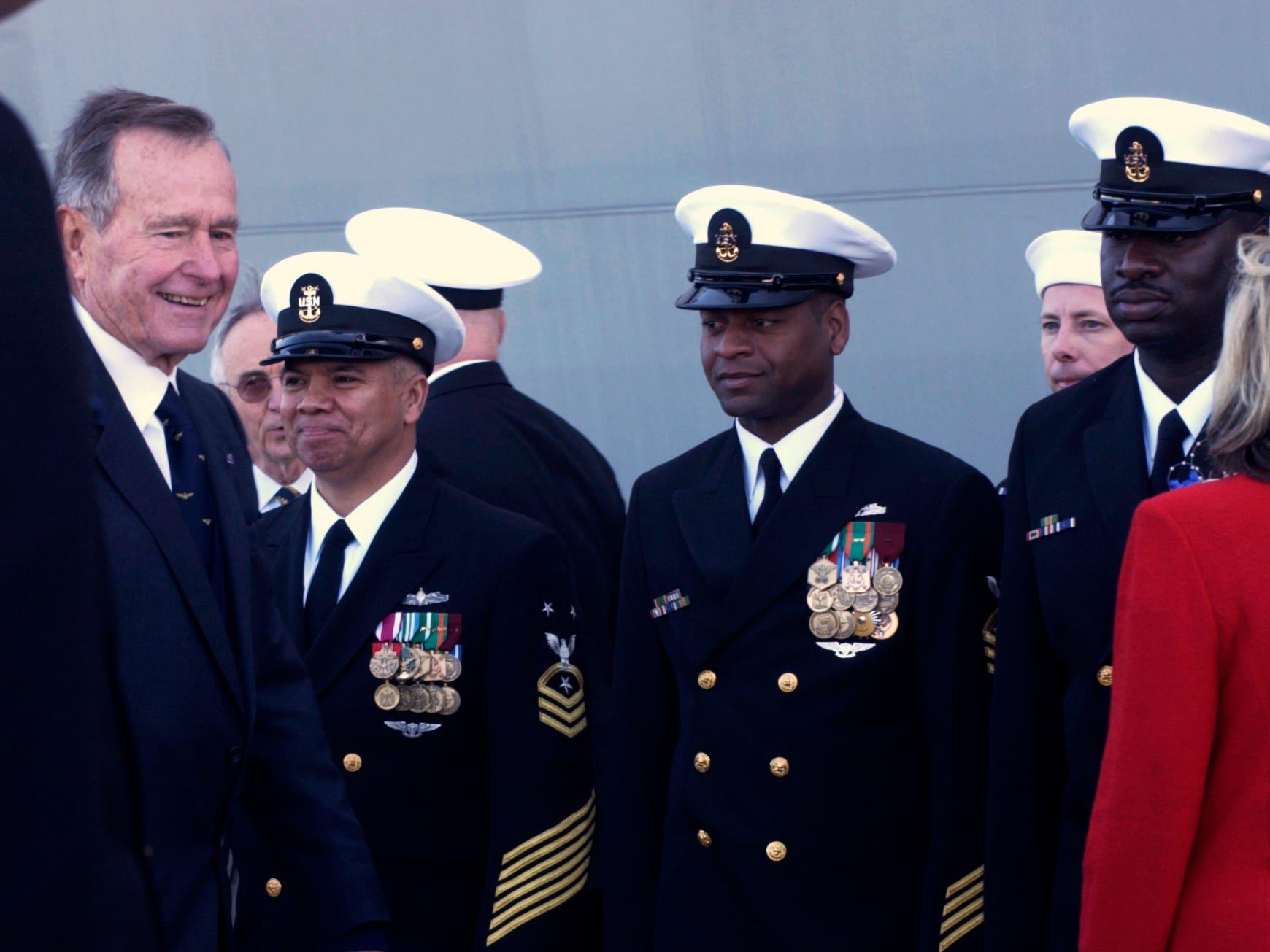 Former President George H.W. Bush (left) participated in the commissioning ceremony of the USS San Antonio at Naval Station Ingleside in January 2006. Former President Bush gave the principal address at the ceremony.