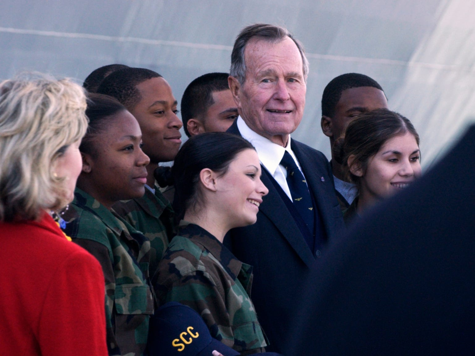 Former President George H.W. Bush (center) participated in the commissioning ceremony of the USS San Antonio at Naval Station Ingleside in January 2006. Former President Bush gave the principal address at the ceremony.