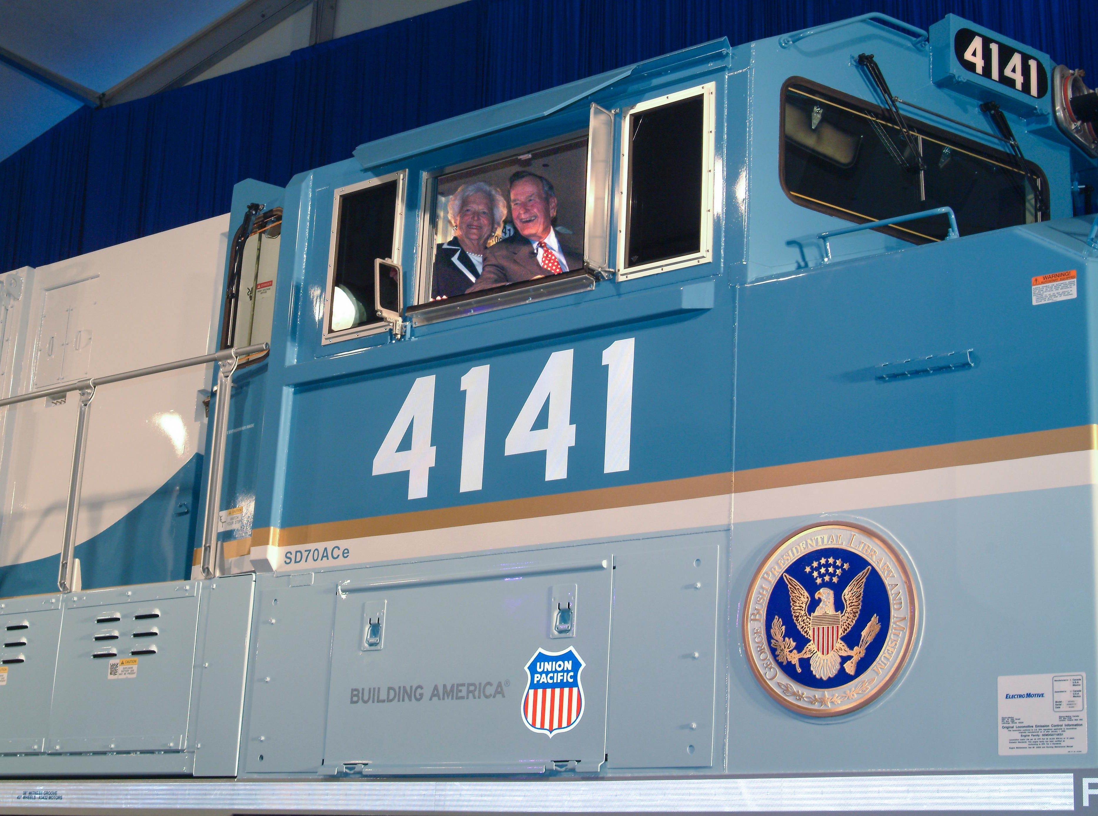 George and Barbara Bush inside the cab of Union Pacific locomotive No. 4141 at its 2005 unveiling.