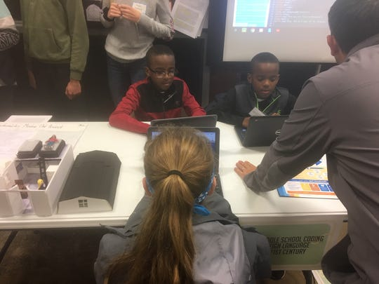Delran Middle School students work on coding at a kickoff event at the future home of the Delran Innovation and Fabrication Laboratory, which will open in the fall of 2019 in a space previously occupied by the former automotive shop at the high school.