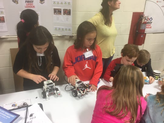 Young Delran Township students work with robots at a kickoff event at Delran High School in the future home of the Delran Innovation and Fabrication Laboratory, which will open in the fall of 2019.