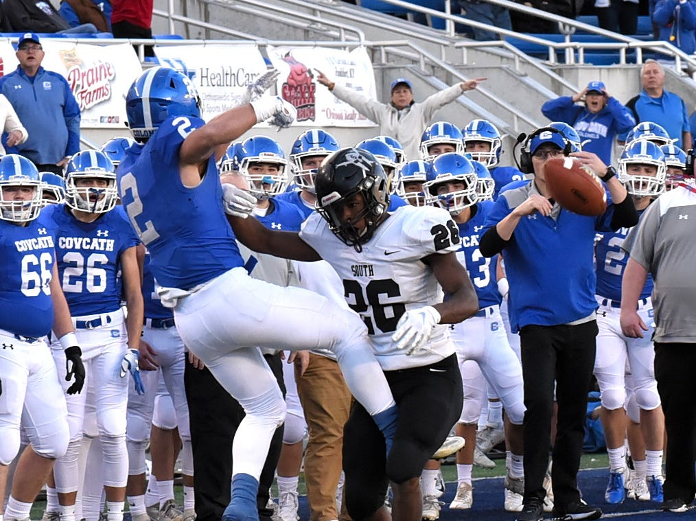 South Warren's Tre Teague opts for a pass interference call to keep Covington Catholic's Casey McGuinness from making a catch to set up a would be Colonels game winning touchdown late in the fourth quarter in the 2018 KHSAA 5A State Football Championship, December 2, 2018.