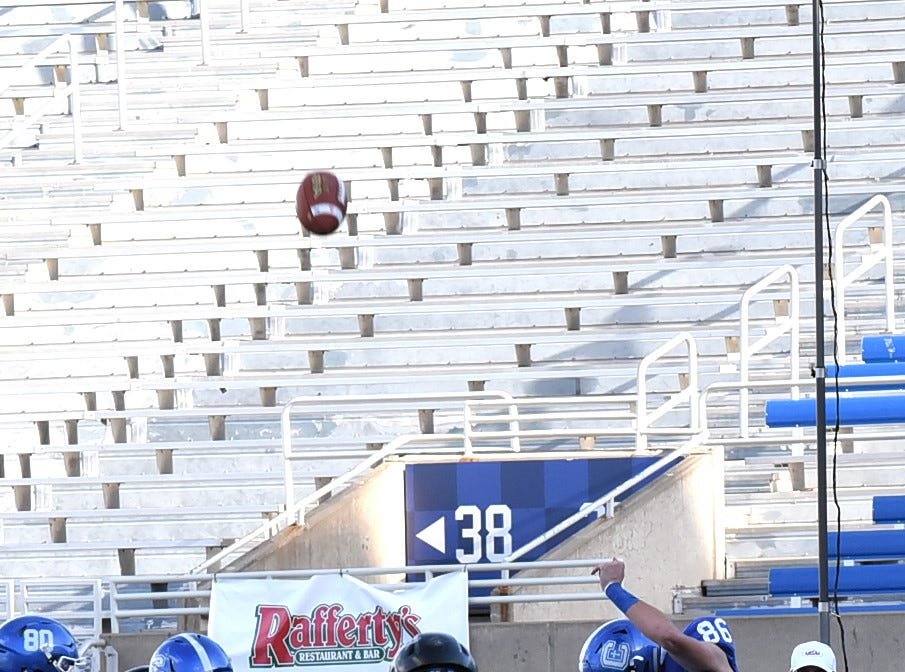 Covington Catholic Punter John Lawrie (86) lifts off a clean punt for the Colonels in the 2018 KHSAA 5A State Football Championship, December 2, 2018.