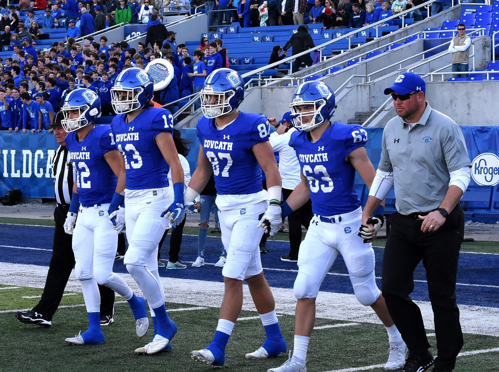 Captains from Covington Catholic head to mid field for the coin toss in the 2018 KHSAA 5A State Football Championship, December 2, 2018.