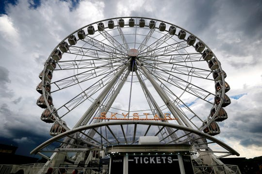 The SkyStar, a multi-colored 150-foot observation wheel that has graced the banks since August, will stay in Cincinnati for six more months, the Cincinnati USA Regional Chamber announced Monday. The SkyStar wheel is a temporary guest to Cincinnati's skyline. It's a celebration of the 10th anniversary of The Banks. Photo shot Saturday September 1, 2018.