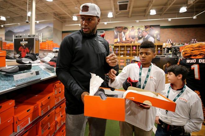 Cincinnati Bengals defensive end Carlos Dunlap shops with a few of the 25 children from Cincinnati Public Schools, North College Hill and Covington, Monday, Dec. 3, 2018, at Dick's Sporting Goods in Newport, Ky.