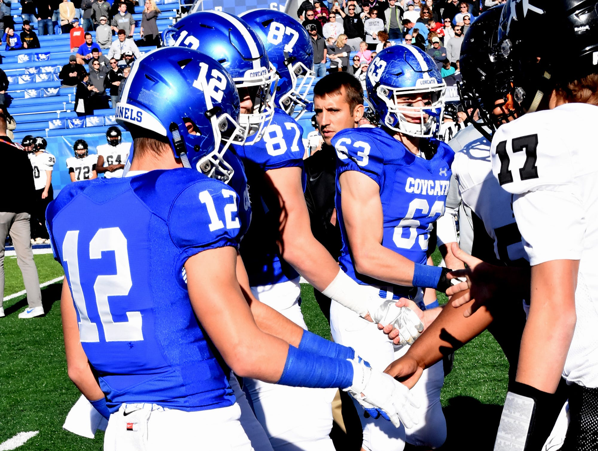 The captains of Covington Catholic shake hands with players from South Waren prior to the start of the 2018 KHSAA 5A State Football Championship, December 2, 2018.