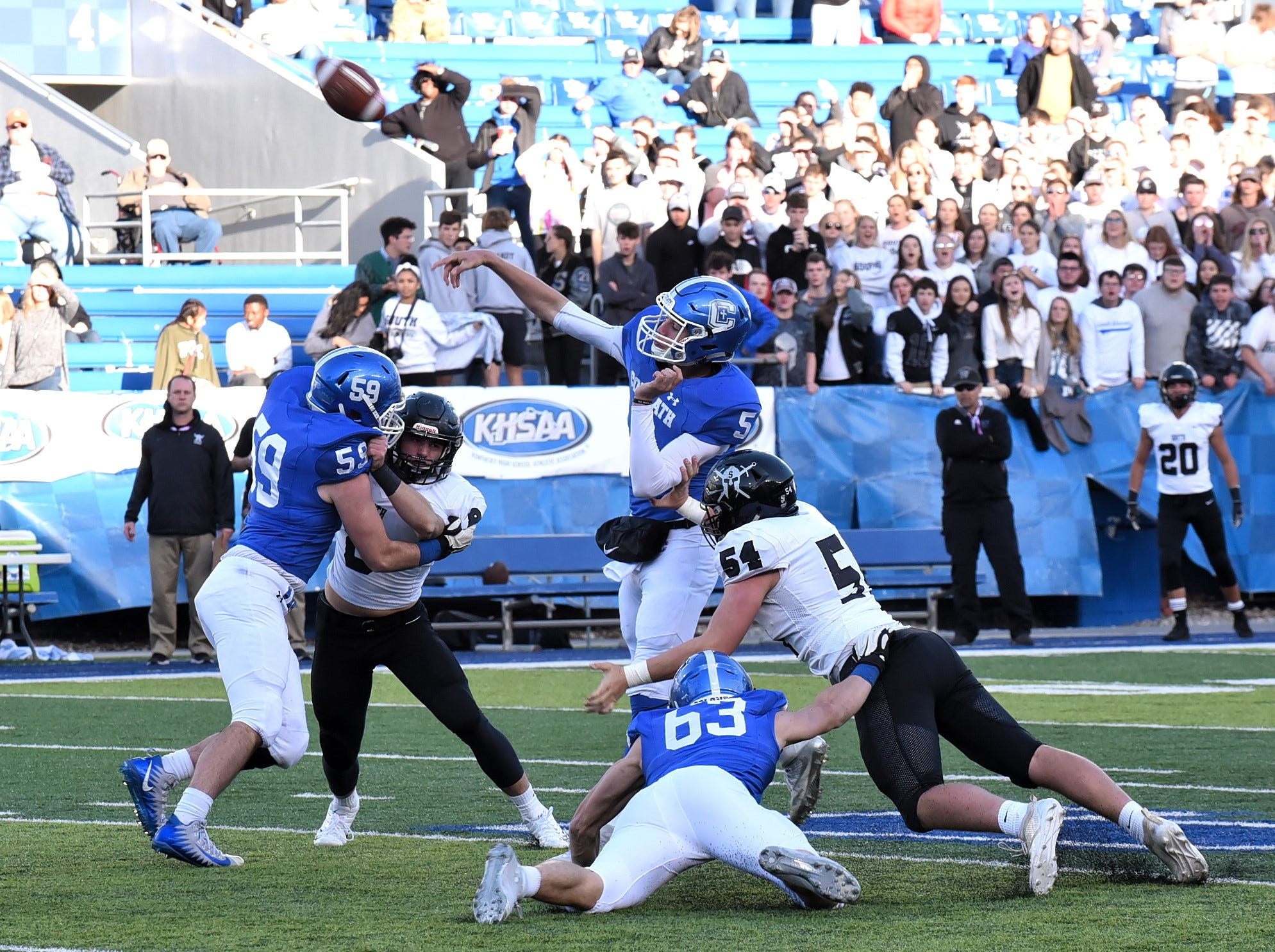 Caleb Jacob (5) fires off a pass to the endzone for Covington Catholic in the 2018 KHSAA 5A State Football Championship, December 2, 2018.